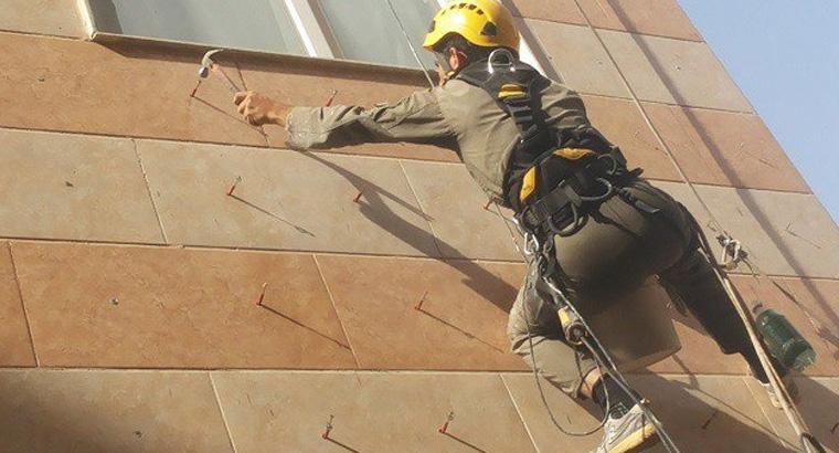 خدمات پیچ و رولپلاک سنگ نمای ساختمان